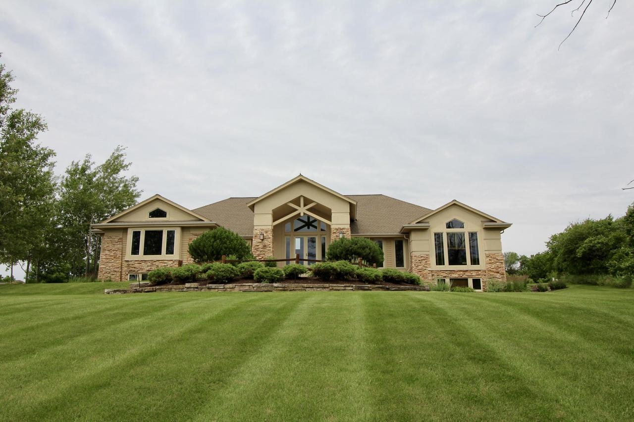 New berlin wi homes over 1000000 for sale set back high on 2 ac is this prairie styled contemporary ranch home landscaped with