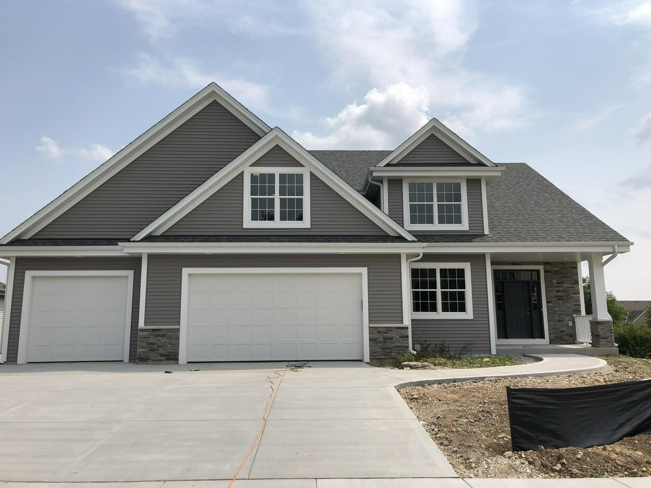 <font color='#C11B17'>Another home sold by Chong Yi Team @ United Realtors!<font color='#0000A0'> This stunning 2 story offers 4BR/2.5BA/3GA/Master Suite w/walk-in closet & private bathroom w/custom walk-in tiled shower. Fireplace in Living room, solid doors w/extra wide trim, granite counters and spacious kitchen & dinette. Lower level offers partial exposure and is plumbed for a full bath. **Ceramic tiles in bathrooms/laminate wood floors in Kitchen & Dinette**  Reserve today! <Photos are from a similar model>