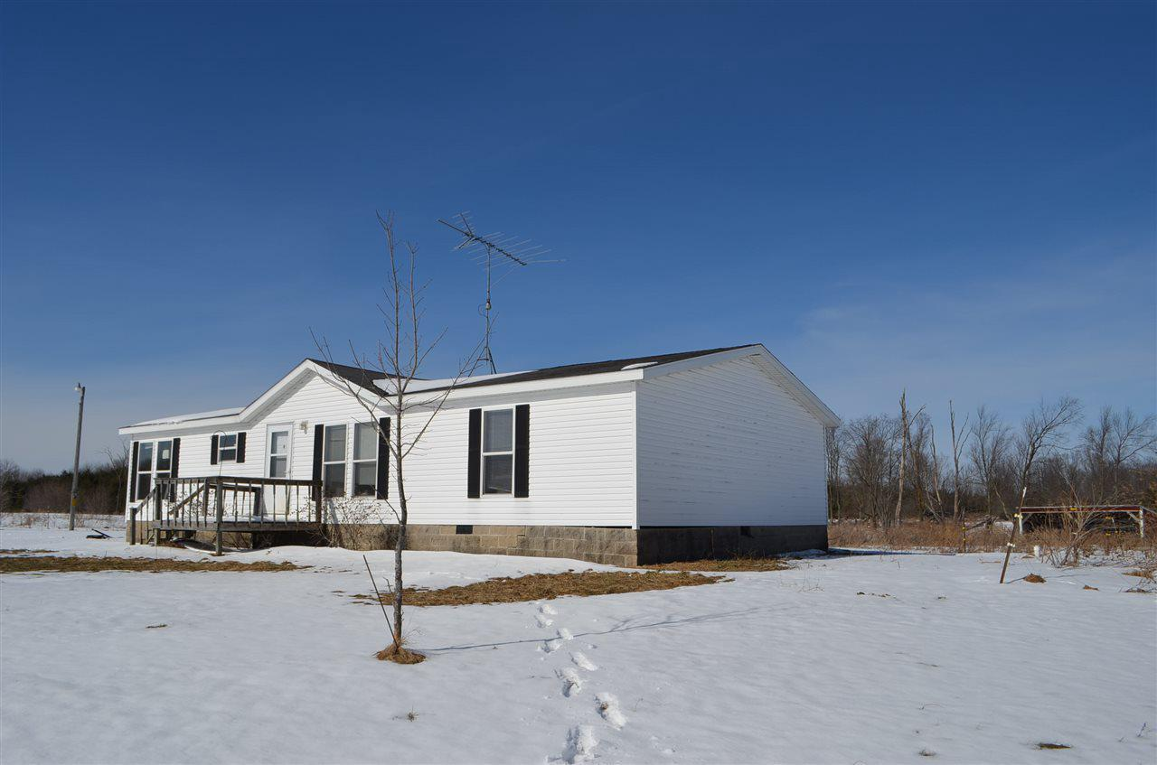 Manufacture home located on 9 +/- Acres, east of Wittenberg, frontage on Highway 29, horse shelter and extra well on property.