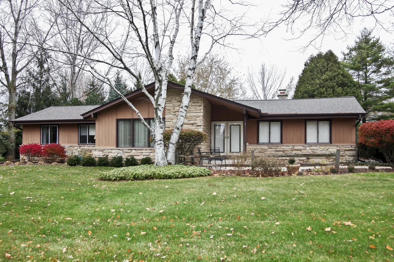 This well cared for ranch home is located in a quiet, convenient, and desirable Mequon neighborhood. This home provides spacious living areas and an easy flow. Perfect for gatherings. An ample foyer entry greets guests and leads them to an inviting sunken living room.  Enter the cozy family room and enjoy the warmth of the floor to ceiling brick fireplace. Bring entertaining outdoors on the secluded patio, surrounded by a well cared for lot with mature trees. Enjoy the great beauty of prairie wildflowers in your own backyard. The newer roof provides peace of mind.