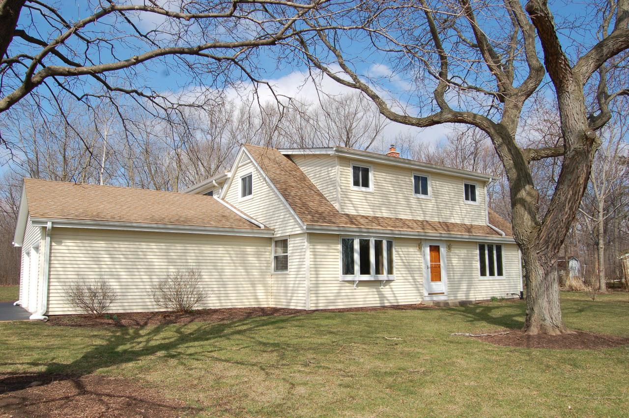 Long time owner offers 5br 3ba cape cod on big private lot in new