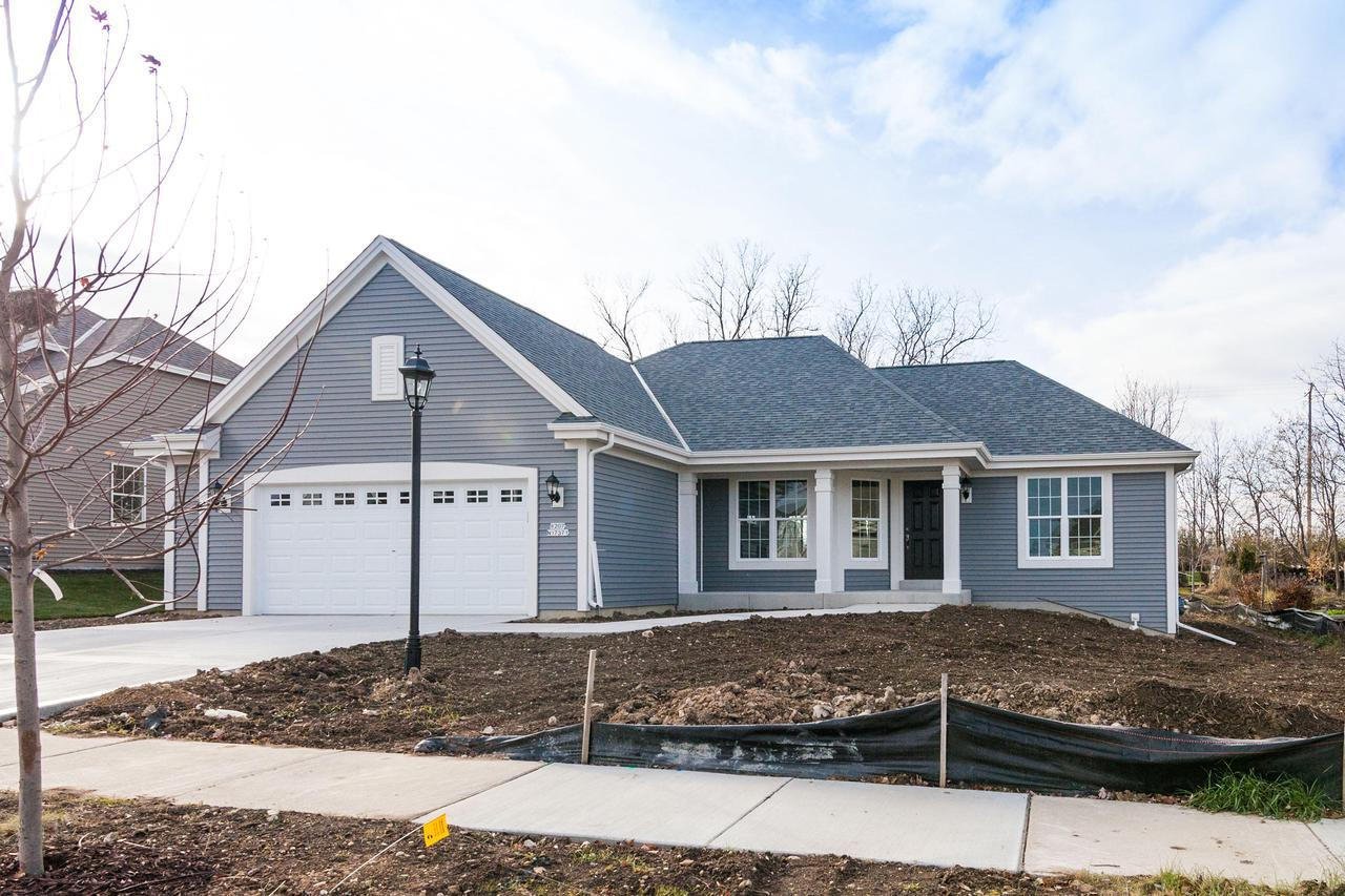 New Construction!  Now being Built!!  The Shorewood 1550 has granite kitchen counters, gas fireplace, wood look laminate flooring in main living areas, oversized 26 x 22 garage, Includes concrete drive, rough in for future half bath at basement, active  radon abatement and moisture control system.Completion September  2017.