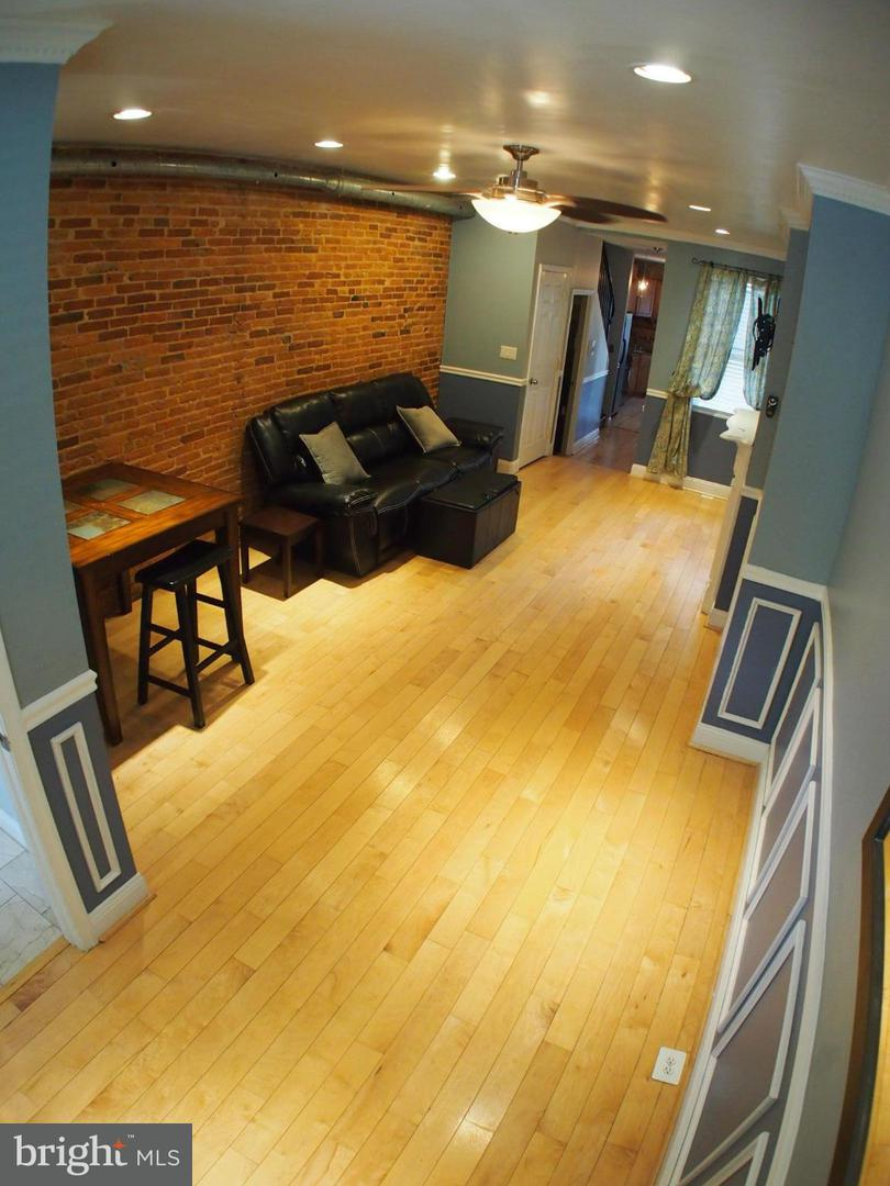 Photo of home for sale at 106 Wolfe Street S, Baltimore MD