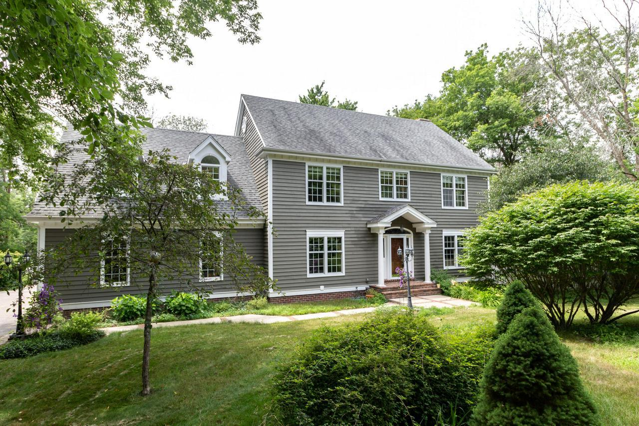 Move right into this spacious 4 bed/3.5 bath custom designed/built Grafton. Colonial on 2 wooded acres with private creek. This one has everything-mud room, first floor laundry, master suite, bedrooms on one floor... Newly upgraded eat-in kitchen opens to family room w/fireplace and to brick patio viaFrench doors. Brand new rec room with wainscot, wet bar and full bathroom.Impeccably maintained & many updates & upgrades installed just for the sale - new carpet, lighting, driveway, paint, rec room and more. Enjoy privacy and country livingbut only 5 minutes away from HWY & Central Grafton.