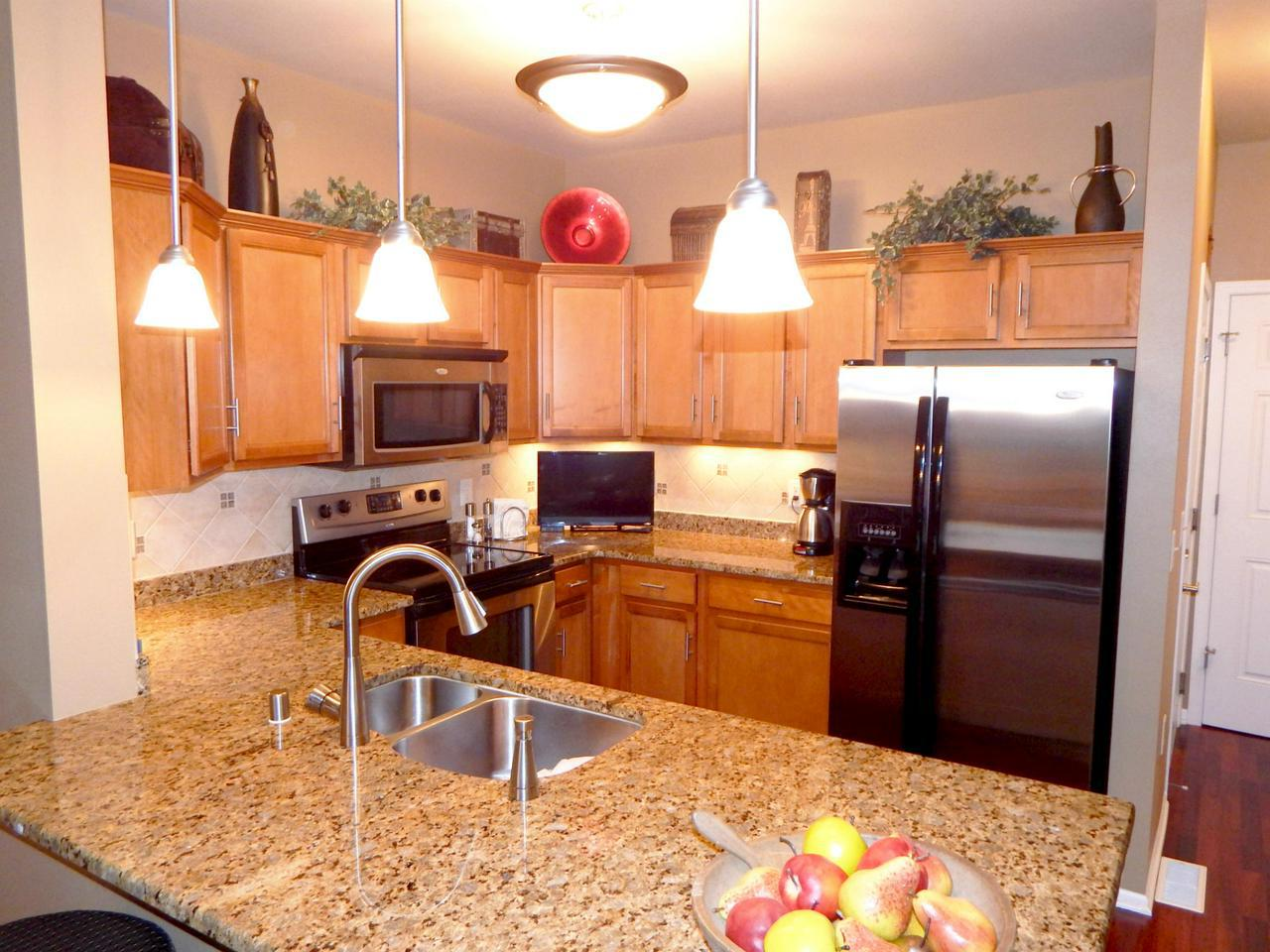 Simply one of the Best New Port Vista has to offer.One of the best locations, floor plans and highest level of upgrades.Very open and bright w/great views.Professional decorated with quality and style.Kitchen w/custom backslash,granite counters,cherry floors,stainless appliances,custom lighting.Great room and dining room with upgraded carpet & custom lighting. 3 full baths all with ceramic tile floors.Custom lighting through out.Gas fireplace,marble entrance,LL great room w/wet bar,full bath, 8ft ceilings and walk out 2nd patio. Outstanding club house w/work out room, hot tub and pool.