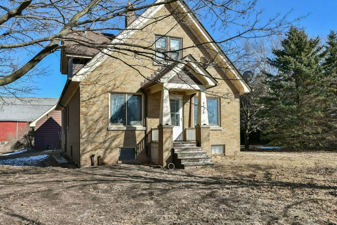 Quiet country living located just north of Port washington. Quality all brick home with beautiful handcrafetd cabinets with original farm sink.
