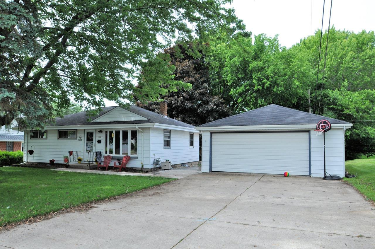 Here is your chance to get a great home in Grafton for under $200K. Great starter home, condo alternative, or downsize option.  Home has 3 bedrooms, 2 full baths, finished rec room in lower level. Main level of home has all hardwood floors, main bath has been updated. Large deck behind 2 1/2 car garage, private yard.This is one of 2 homes in Grafton under $200,000 at this time, it won't last long! Call today for a private appointment to view this home.
