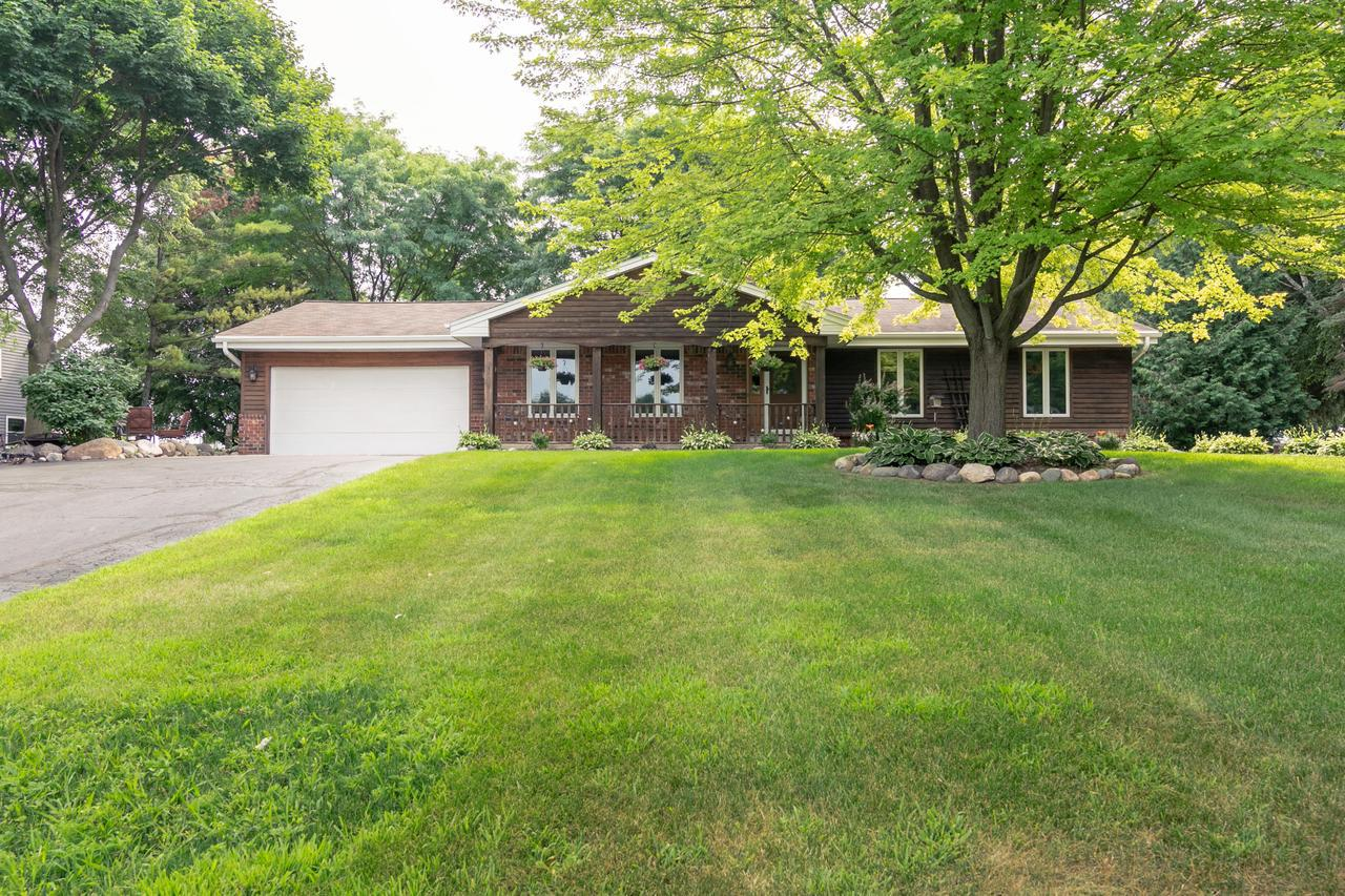 You will love the beauty & quiet of a rural lifestyle w/convenient access to schools, shopping & dining. The neighborhood is very private & quiet w/little traffic. This 1723sq ft ranch home is on a .92 acre lot that features a 2 car garage. Additional parking for 3 vehicles on side of driveway & 1 car garage in the backyard. The house has natural cedar siding, brick & vinyl siding. Step inside to 3 BR 2 BA, LRG LR, kitchen is newly tiled, new counter tops, tons of cabinet space including a pantry & beautiful bay window. New SS appliances. Off the kitchen is the FR W/natural brick fireplace, new laminate wood flr, glass sliding doors leading to the double-sized natural wood deck overlooking the spectacular backyard. Just off the kitchen is a main floor laundry w/newer washer & dryer.