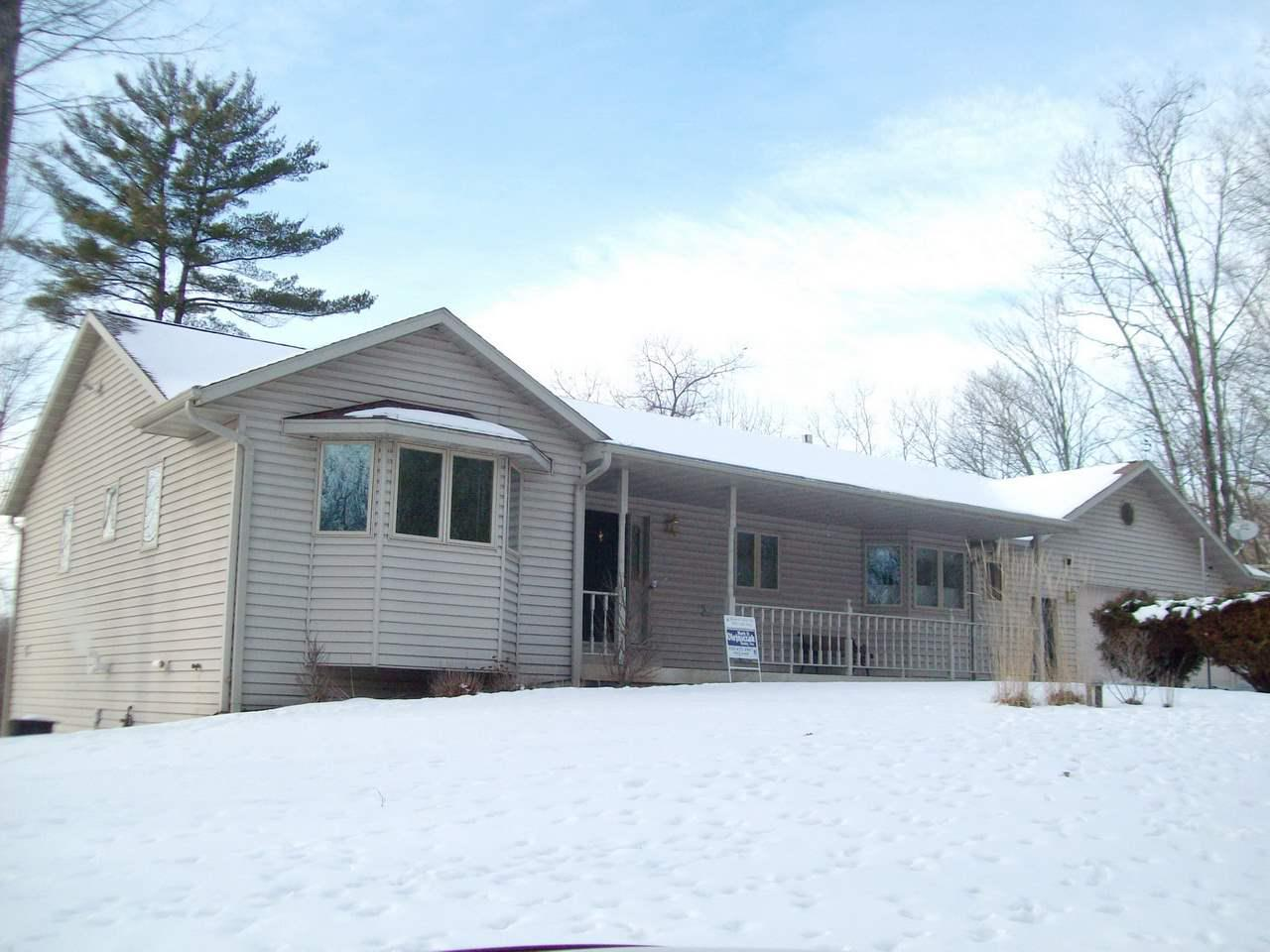 Custom-built walk-out ranch on 1.61 wooded acres. Double lot w/220 ft frontage on Unnamed Lake. Located at end of private rd. $150 annual fee covers rd maintenance, plowing & stocking lake w/fish. Fam Rm & bath on LL w/patio doors. Needs flooring. W/B free-standing stove-Fam Rm. Gasfree-standing FP-LR. Oak cabinets and 6-panel doors. Kit appliances, washer, dryer incl. Lake approx 48 ft deep.