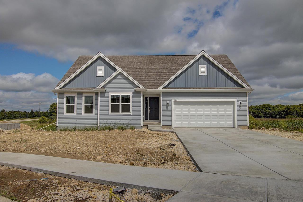 Energy-Efficient NEW Construction built for the way YOU live - Ready August 2018! The Jackson Ranch plan is a 3BR/2BTH in an open concept design. Kitchen offers a corner pantry and sit-at island that is open to the GR and dinette for easy entertaining and gathering. Home highlights include split vanities in the Master BR, fireplace in GR, Look-out LL, and storage space through-out. Anticipated Drywall Completion: 6/6/18Anticipated Trim Completion: 7/06/18