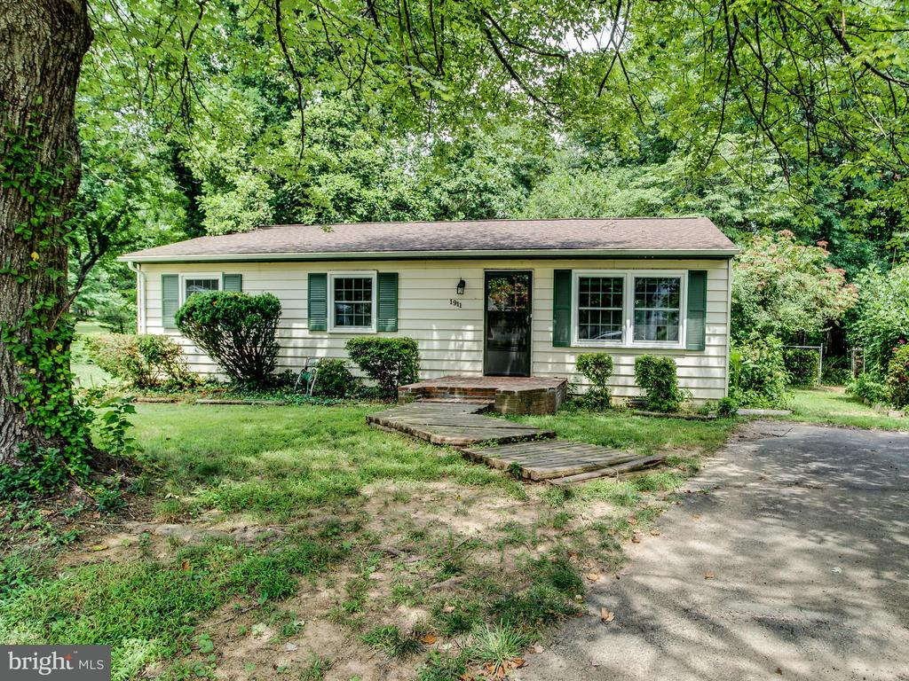"""Appraised for $620K in July! HUGE .57 acre LOT ON CUL-DE-SAC BACKING TO OLNEY PARK!Home sold """"as is"""" but in livable condition.Renovate,build,or move right in.Great investment potential.Easy access to Silver Metro,Tysons,shopping,66,495,& Dulles Toll Rd.Wood floors throughout mn lvl,fenced in yard w/ shed.New kitchen cabs & counters (2017),roof (2012),windows (2010),& updated light fixtures."""