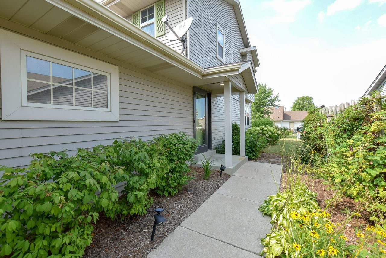 Walking distance to school & church in a nice neighborhood, this side x side condo offers an open concept main level with a first floor laundry room and 2 car attached garage. 2 generous bedrooms upstairs and a wonderful Family Room in the lower level with a gas fireplace. Lots of room in a great location. Private entrance with an attached garage and full basement, is hard to find! Reasonable condo fees and taxes makes this affordable living!