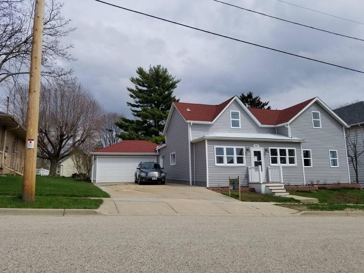 Pack you things, gather your kids, and grab the dog. Your new home is waiting for you. Great starter home for a small family. Fully gutted and rebuilt 3 bedroom, 1.5 bath, 1420 sqft, large 2.5 car garage on .17acres. Blocks from downtown. New electrical, plumbing, HVAC, windows, doors, siding, flooring, cabinets, appliances, EVERYTHING! Features a large mud room/ first floor laundry, walk in pantry, heated front enclosed porch, attached workshop and more. Dont miss out on a truly move in ready home. Call today for your private showing.