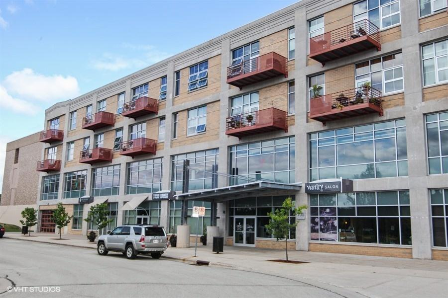 Bright and Beautiful River Shores Loft Condo! Living Room/Kitchen open concept with 12 foot ceilings. Master Bedroom with walk-in closet, and plenty of added shelving for your storage needs. Den can be used as 2nd bedroom. In unit washer and dryer with more added shelving. Unit includes storage space & 1 parking space. Association Fees include high speed internet and basic cable. East facing balcony overlooking the Eisenbahn State Trail. A discounted membership to the YMCA on the 2nd level is available to unit owners.
