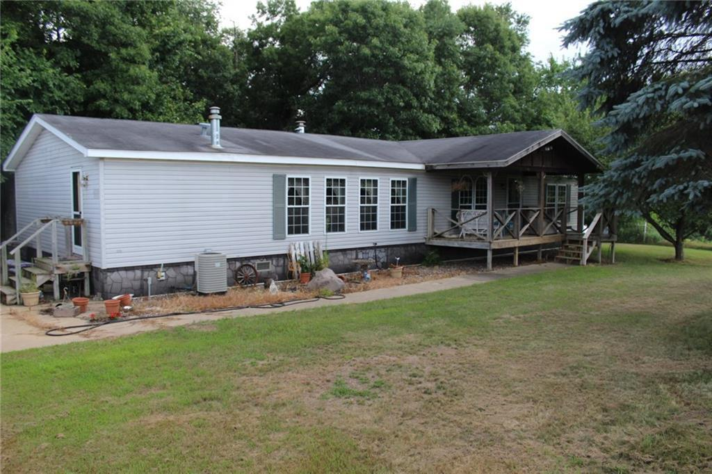 Located on a quiet dead-end road just outside of Northfield, WI, this potential hobby farm is turn-key and ready for a new owner. Property consists of a 3bd-2ba double wide home w/2-car detached garage and loafing shed, sitting on 40 acres (20 tillable-15 wooded-5 pasture). Seller has had horses and cattle on property with fencing in place. Tillable is rented and the woodland holds plenty of deer and turkeys for the hunter. Enjoy watching the wildlife off the front porch! Call today for info!