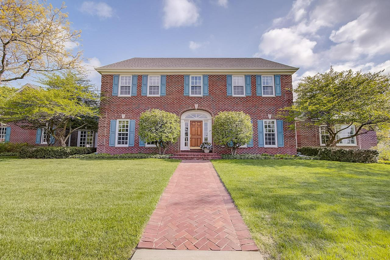 Beautiful beyond words! Custom all-brick Colonial boasts 5 spacious BDRMS, 3 Full BAs, 2 Half BAs & spans over 5,200 sqft on a scenic .55 Acre lot! This marvelous home welcomes you with a grand entry & sweeping staircase drawing you to a spacious layout splashed with fine cherry hardwoods. Magnificent Great Room w/ handsome FP & 10FT Ceilings opens to incredible Kitchen catering to the home chef. French Doors lead to 4 season room overlooking exquisite inground heated pool. Laundry conveniently located on main level includes W/D. Divine Main Level Master w/his/her WICs. NEW ROOF. 3 Car GAR!