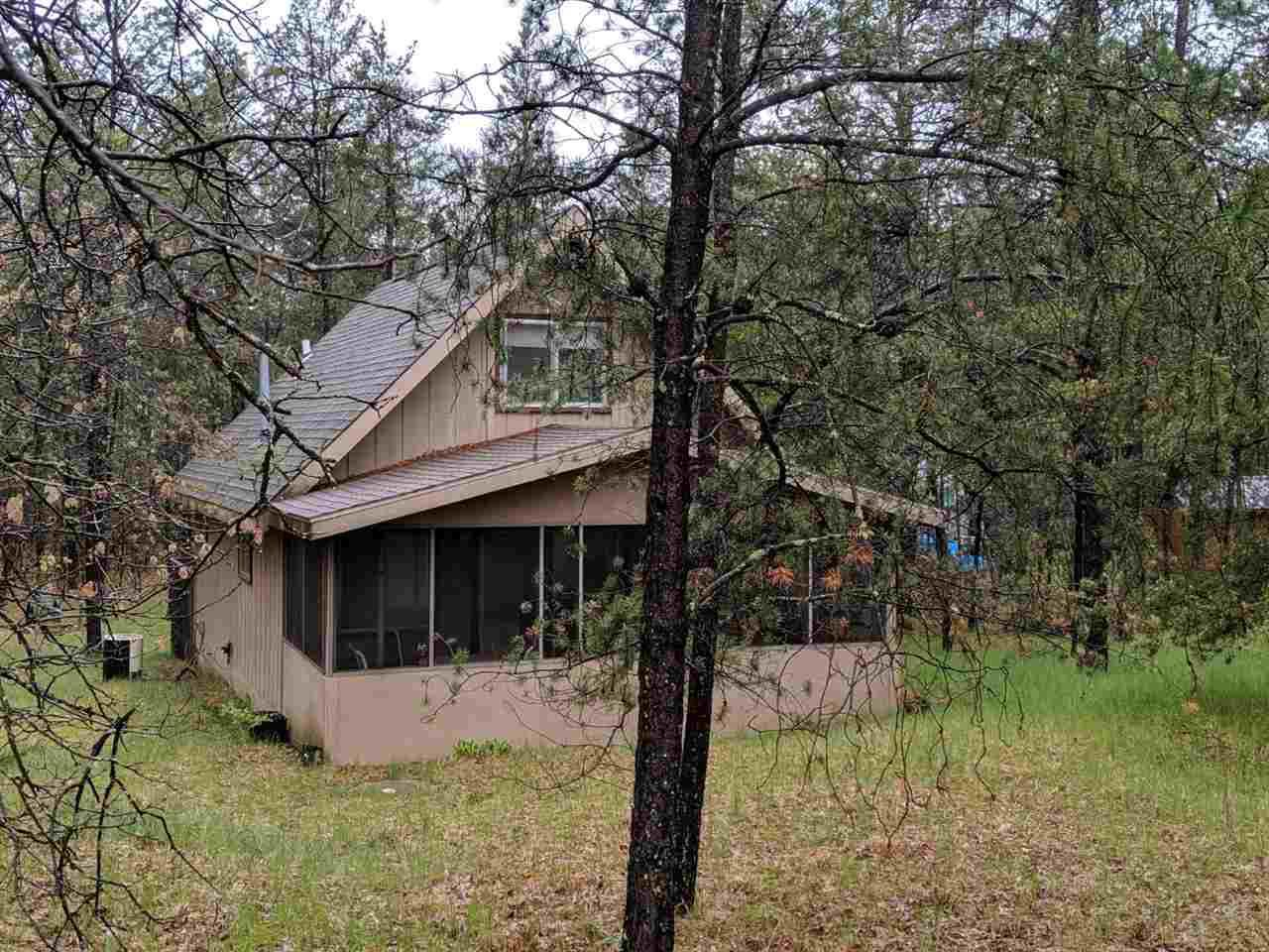 Nestled in the trees, a 2 bedroom, 2 bath cabin within a mile of Castle Rock Lake. Cabin comes fully furnished and ready for you to move in. Large deck to sit and relax or to have friends and family come over and enjoy a cook out. A storage shed for toys. Come enjoy all that Adams County has to offer: fishing, boating, golf, ATV and snowmobile trails, horseback riding. Within 30 miles of Wisconsin Dells. This is the perfect getaway.