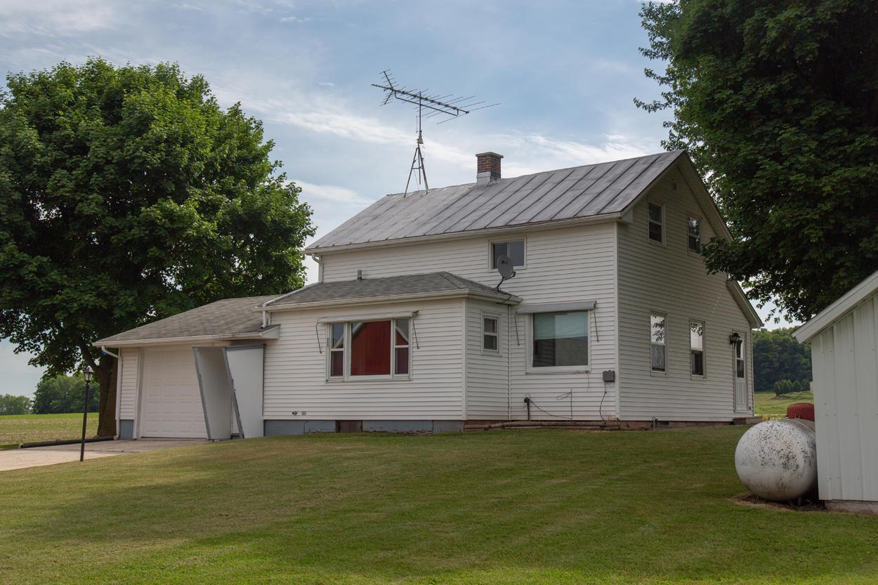 Town of Rhine hobby farm with a great location and lots of space for family, animals, equipment, hobbies and more. This 3+ bedroom farm house has 1.5 baths, a large eat-in kitchen and an attached garage. The property has a nice barn, detached garage with shop, machine shed, chicken coop and other smaller sheds. The general condition varies on these buildings but overall it's a great buy!